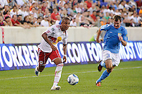 Juan Agudelo (17) of the New York Red Bulls is chased by Josiah Snelgrove (3) of FC New York. The New York Red Bulls defeated FC New York 2-1 during a third round match of the 2011 Lamar Hunt US Open Cup at Red Bull Arena in Harrison, NJ, on June 28, 2011.