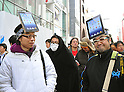March 16, 2012, Tokyo, Japan - Braving the early morning chill, Japanese Apple manias line up well before the release of the New iPad at the flagship store of Sioftbank, Apples Japanese retailer in Tokyos Ginza district on Friday, March 16, 2012. (Photo by Natsuki Sakai/AFLO) AYF -mis-