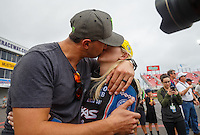 May 1, 2016; Baytown, TX, USA; IndyCar Series driver Graham Rahal (left) kisses wife NHRA funny car driver Courtney Force after winning the Spring Nationals at Royal Purple Raceway. Mandatory Credit: Mark J. Rebilas-USA TODAY Sports