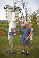 Naturalist dedicates purple martin bird house for ecology environmental purpose.