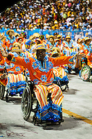 Handicapped dancers of Portela samba school perform on wheel chairs during the Carnival parade at the Sambadrome in Rio de Janeiro, Brazil, 20 February 2012. The Carnival in Rio de Janeiro, considered the biggest carnival in the world, is a colorful, four day celebration, taking place every year forty days before Easter. The Samba school parades, featuring thousands of dancers, imaginative costumes and elaborate floats, are held on the Sambadrome, a purpose-built stadium in downtown Rio. According to costumes, flow, theme, band music quality and performance, a single school is declared the winner of the competition.