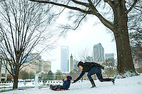 Charlotte Snow Photography - Photography of a mother and her two sons sledding in Marshall Park in uptown Charlotte North Carolina. <br /> <br /> Photography of snow scenes in Charlotte North Carolina.<br /> <br /> Charlotte Photographer - PatrickSchneiderPhoto.com