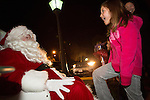 Children talk with Santa during a tree lighting ceremony Dec. 7 at Rancho Shopping Center in Los Altos.