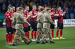 Dundee v St Johnstone....08.11.14   SPFL<br /> Soldiers from The Black Watch parade onto the pitch prior to kick off<br /> Picture by Graeme Hart.<br /> Copyright Perthshire Picture Agency<br /> Tel: 01738 623350  Mobile: 07990 594431