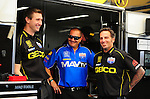May 6, 2012; Commerce, GA, USA: NHRA Aaron Brooks (right), crew chief for top fuel dragster driver Morgan Lucas (left) with Brandon Bernstein during the Southern Nationals at Atlanta Dragway. Mandatory Credit: Mark J. Rebilas-
