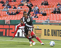 Rodney Wallace #22 of D.C. United knocks the ball away from Atiba Harris #16 of F.C. Dallas during a US Open Cup match on April 28 2010, at RFK Stadium in Washington D.C. United won 4-2.