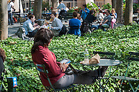 A reader uses her Amazon Kindle electronic book in Bryant Park in New York on Thursday, September 27, 2012, 2012 (© Richard B. Levine)