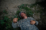 Wracked by dysentery after sharing tea with an Afghan, Private Dan Burris of the 82nd Airborne's, 1/508, Alpha Co., Third Platoon, tries to recover in Sangin, Helmand province, Afghanistan on Saturday, April 7, 2007.