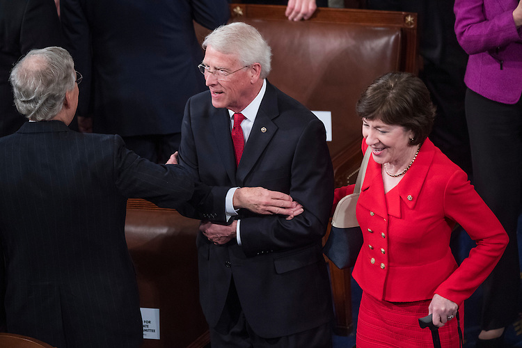 UNITED STATES - FEBRUARY 28: Sen. Roger Wicker, R-Miss., escorts Sen. Susan Collins, R-Maine, into the House Chamber before President Donald Trump addressed a joint session of Congress in the Capitol, February 28, 2017. (Photo By Tom Williams/CQ Roll Call)