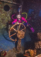 10 June 2014: SCUBA Diver Sally Herschorn explores the wheelhouse of the USS Kittiwake, a former United States Navy submarine rescue vessel, off Seven Mile Beach, on the West Shore of Grand Cayman Island. Purchased by the government of the Cayman Islands, the Kittiwake was intentionally sunk on January 5, 2011, to create an artificial reef in the Cayman Marine Park. Located in the British West Indies in the Caribbean, the Cayman Islands are renowned for excellent scuba diving, snorkeling, beaches and banking.  Mandatory Credit: Ed Wolfstein Photo *** RAW (NEF) Image File Available ***