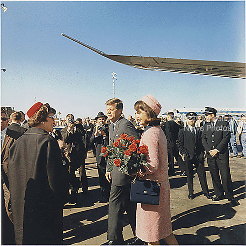 United States President John F. Kennedy and First Lady Jacqueline Kennedy arrive at Dallas, Texas, Love Field on November 22, 1963.<br /> Credit: Cecil Stoughton/White House via CNP