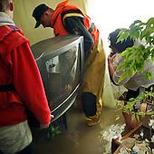 NOWY WIONCZENIN, POLAND, MAY 24, 2010:.Rescue workers at flooded house of Krystyna Ciastek..The latest chapter of disastrous floods in Poland has been opened yesterday, May 23, 2010, after Vistula river broke its banks and flooded over 25 villages causing evacualtion of most inhabitants..Photo by Piotr Malecki / Napo Images..NOWY WIONCZENIN, POLSKA, 24/05/2010:.Zatopiony dom Krystyny Ciastek.  Najnowszy akt straszliwych tegorocznych powodzi zostal rozpoczety wczoraj gdy Wisla przerwala waly na wysokosci wsi Swiniary kolo Plocka..Fot: Piotr Malecki / Napo Images ..