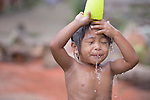 A child bathes on Jinamoc Island, part of the municipality of Basey in the Philippines province of Samar that was hit hard by Typhoon Haiyan in November 2013. The storm was known locally as Yolanda, and left most of the island's boats, nets, and houses destroyed. The ACT Alliance has been providing a variety of assistance to survivors here, and is planning a long-term rehabilitation program with residents.