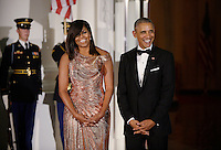 President Barack Obama and First Lady Michelle Obama wait for Prime Minister of Italy Matteo Renzi and Mrs. Agnese Landini to arrive at the North Portico  of the White House on October 18, 2016 in Washington, DC. <br /> Credit: Olivier Douliery / Pool via CNP / MediaPunch