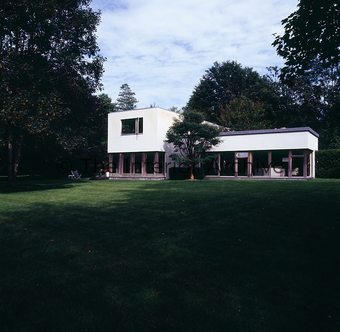 The exterior of the modern house from the garden