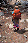 Child (age 4) with pack hiking on the Morgan Pass Trail, Sierra Nevada Mountains, John Muir Wilderness, California
