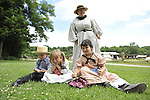 MICHELE WALKER (rear) of Coram; (L to R) ROBERT WALKER 4; JULIAN LYNN ZOLL, 6, of Levittown; and MADELYN WALKER, 7, wear clothes of American Civil War era while portraying family members of Union soldiers at Camp Scott re-creation, at Old Bethpage Village Restoration, to commemorate 150th Anniversary of American Civil War, on Saturday, July 21, 2012, in Old Bethpage, New York, USA.