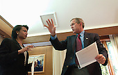 United States President George W. Bush meets with National Security Advisor Condoleezza Rice inside his office at Camp David, Maryland, Sunday morning, September 16, 2001. .Mandatory Credit: