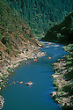 Rafting and kayaking the Rogue River in the Hellgate Recreation Area between Wooldridge Riffle and Graves Creek; southwestern Oregon.