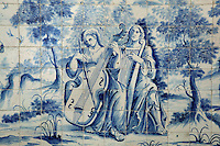 Musicians playing the cello and the harp, from scenes of the history of the monastery and the Siege of Lisbon in 1147, traditional blue and white azulejos tile scene, 18th century, in the Monastery of Sao Vicente de Fora, an Augustinian order monastery and church built in the 17th century in Mannerist style, Lisbon, Portugal. The monastery also contains the royal pantheon of the Braganza monarchs of Portugal. Picture by Manuel Cohen
