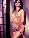 Beautiful naked Japanese woman edited to look like a Hentai anime character standing at a wall with tied hands. Bondage Shibari art nude photo illustration.