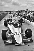 HAMPTON, GA - APRIL 22: Gordon Johncock stands at the rear wing of his Penske PC6/Cosworth TC while George Bignotti inspects the right rear suspension in the pit lane before practice for the Gould Twin Dixie 125 event on April 22, 1979, at Atlanta International Raceway near Hampton, Georgia.