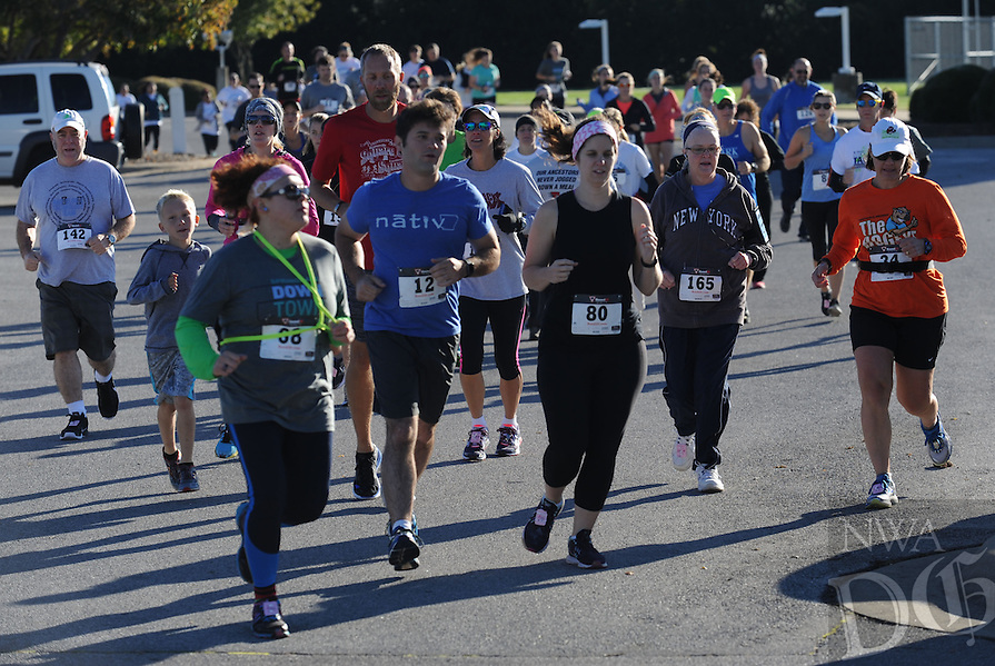 NWA Democrat-Gazette/ANDY SHUPE<br /> Runners take part Saturday, Oct. 8, 2016, in the inaugural Springdale Downtown Runaround race and fun run at the Jones Center in Springdale. Visit nwadg.com/photos to see more photographs from the race.