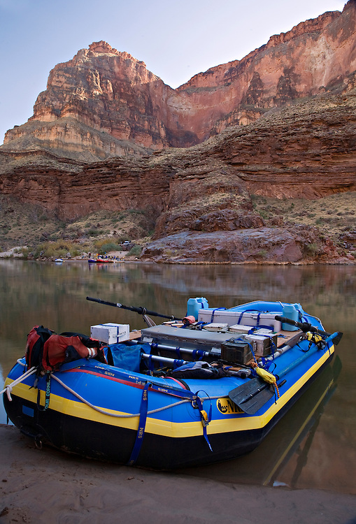 A raft from a private river rafting group rests on the beach at Deer Creek Falls as the group makes camp across the Colorado River.