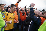 Wealdstone 0 Newport County 0, 17/03/2012. St Georges Stadium, FA Trophy Semi Final. Visiting supporters and players celebrating at the final whistle on the pitch at St Georges Stadium, home ground of Wealdstone FC, as the club played host to Newport County (yellow) in the semi-final second leg of the F.A. Trophy. The game ended in a goalless draw, watched by a capacity crowd of 2,092 which meant the visitors from Wales progressed by three goals to one to the competition's final at Wembley, where they would meet York City. The F.A. Trophy was the premier cup competition for non-League clubs in England and Wales affiliated to the Football Association. Photo by Colin McPherson.