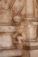 Sculptural detail of a lion trapped between stone slabs, in the arcade of the Cloister, built in Manueline style by Diogo Boitac, Joao de Castilho and Diogo de Torralva, completed 1541, in the Jeronimos Monastery or Hieronymites Monastery, a monastery of the Order of St Jerome, built in the 16th century in Late Gothic Manueline style, Belem, Lisbon, Portugal. The cloister wings have wide arcades with rectangular column and tracery within the arches. The monastery is listed as a UNESCO World Heritage Site. Picture by Manuel Cohen