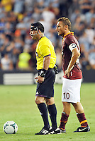 Sporting Park, Kansas City, Kansas, July 31 2013:<br /> Referee Hilario Grajeda wearing camera on head band stands next to AS Roma captain Francesco Totti.<br /> MLS All-Stars were defeated 3-1 by AS Roma at Sporting Park, Kansas City, KS in the 2013 AT &amp; T All-Star game.