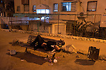 An Ultra-Orthodox Hassidic Jewish man sleeps on a bench after going drunk, as his community celebrates the holiday of Purim in the city of Beit Shemesh, close to Jerusalem, Israel.