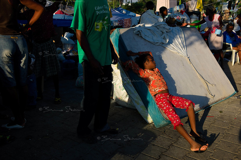 Port Au Prince, Haiti, Jan 17 2010.The entire population of the city sleeps outside, usually on the ground. Fortunately, the weather is fine and there hasn't been any rain since the earthquake struck..