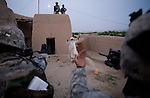 Members of the 82nd Airborne's 1/508 Parachute Infantry Regiment search an Afghan's home after staging a nighttime air assault into Sangin, Helmand province, the largest air assault in Afghanistan since the beginning of the war, on Thursday, April 5, 2007.