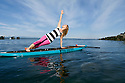 PE00294-00...WASHINGTON - Carly Hayden doing paddle board yoga in the Puget Sound at Brackett's Landing North, Edmonds.  (MR #H13)