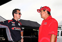 Sept. 1, 2013; Clermont, IN, USA: NHRA top fuel dragster driver Steve Torrence (left) talks with his father Billy Torrence during qualifying for the US Nationals at Lucas Oil Raceway. Mandatory Credit: Mark J. Rebilas-