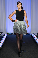 Model walks runway in an outfit by Sara Louise Coccioletti, for the Syracuse University, College of Visual and Peforming Arts 2011 Fashion Show Gala.