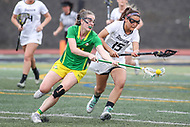 Towson, MD - March 25, 2017: Oregon Ducks Bella Pyne (14) gets the ground ball from Towson Tigers Maddie Tribbe (15) during game between Towson and Oregon at  Minnegan Field at Johnny Unitas Stadium  in Towson, MD. March 25, 2017.  (Photo by Elliott Brown/Media Images International)