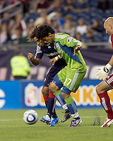 Seattle Sounders FC forward Fredy Montero (17) attempts to receive a cross as New England Revolution defender Kevin Alston (30) defends. The New England Revolution defeated the Seattle Sounders FC, 3-1, at Gillette Stadium on September 4, 2010.