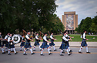 The Notre Dame Bagpipe band marches past the library...Photo by Matt Cashore/University of Notre Dame