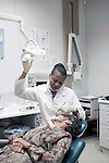PRETORIA, SOUTH AFRICA - MAY 14: Dentist Tswaledi Papo examines a patient in her dentist office on May 14, 2010, in Pretoria, South Africa. Tswaledi is part of the new young generation of black South African's who has obtained a better education and opportunities than their parents. Many grew up in the dire townships of the country and was fortunate to receive a good education and a chance to a better life. (Photo by Per-Anders Pettersson)