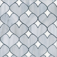 Hearts, a glass waterjet mosaic shown in Pearl and Moonstone, is part of the Erin Adams Collection for New Ravenna Mosaics.