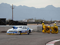 Feb 23, 2014; Chandler, AZ, USA; NHRA pro stock driver Allen Johnson pulls off the track after winning the Carquest Auto Parts Nationals at Wild Horse Pass Motorsports Park. Mandatory Credit: Mark J. Rebilas-USA TODAY Sports