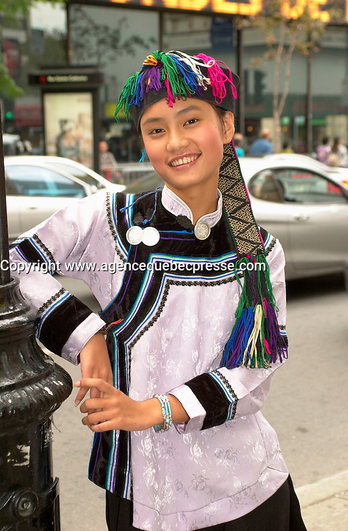 Sept 2,  2003, Montreal, Quebec, Canada<br /> <br /> Li Min, main actress in Zhang Jiarui movie<br /> RUOMA DE SHI SUI (When Ruoma was seventeen), presented in the Official Competition of the<br />  2003 Montreal World Film Festival, pose for an exclusive photo in the street of Montreal.<br /> <br /> She is an ordinary schoolgirl choosen among 1500 others of an ethnic minority, for the main role in the first Chinese independant film on ethnic HANI tribe<br /> <br /> The Festival runs from August 27th to september 7th, 2003<br /> <br /> <br /> Mandatory Credit: Photo by Pierre Roussel- Images Distribution. (&copy;) Copyright 2003 by Pierre Roussel <br /> <br /> All Photos are on www.photoreflect.com, filed by date and events. For private and media sales