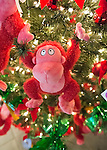 Garden City, New York, USA. November 30, 2013. At the Winter holiday Festival of Trees, the First Place winner for Modern Contemporary trees was the 'Going Ape Over Christmas' tree decorated with Hallmark orange pink gorilla stuffed toys. The event was held at Cradle of Aviation Museum during Thanksgiving weekend, and all proceeds benefited the United Cerebral Palsy Association of Nassau County, Long Island.