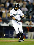 Seattle Mariners' Ichiro Suzuki, of Japan looks at his bat after foul tipping a ball against the Baltimore Orioles   at Safeco Field in Seattle on June 6, 2007.  Jim Bryant Photo. ©2010. ALL RIGHTS RESERVED.