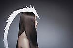 Asian female model in profile wearing long white headdress