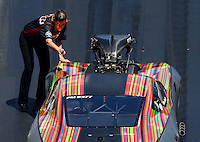Jun 18, 2016; Bristol, TN, USA; Cassie Simonton , crew member for NHRA pro mod driver Von Smith during qualifying for the Thunder Valley Nationals at Bristol Dragway. Mandatory Credit: Mark J. Rebilas-USA TODAY Sports