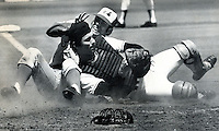 Giant catcher Dave Rader is hit with a hard slide from Expo Ron Hunt but hangs on for the out. (1973 photo by Ron Riesterer)