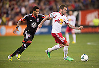 Raphael Augusto (12) of D.C. United tries to take the ball away from Jonny Steele (22) of New York Red Bulls during the game at RFK Stadium in Washington, DC.  New York Red Bulls defeated D.C. United, 2-0.